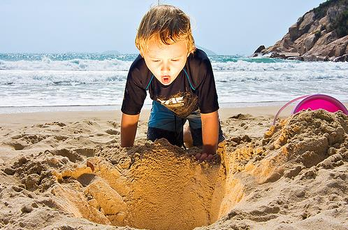 kid in the sand